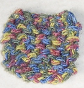 1. Start with a small knitted or crochet patch
